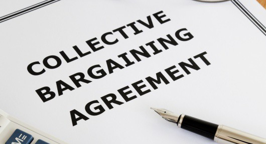 Image of a collective bargaining agreement on an office table.